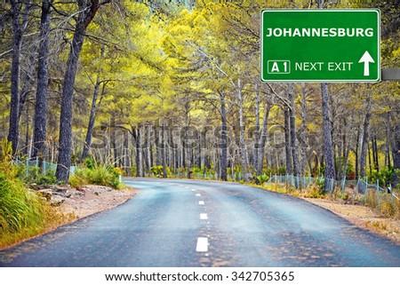 JOHANNESBURG road sign against clear blue sky - stock photo