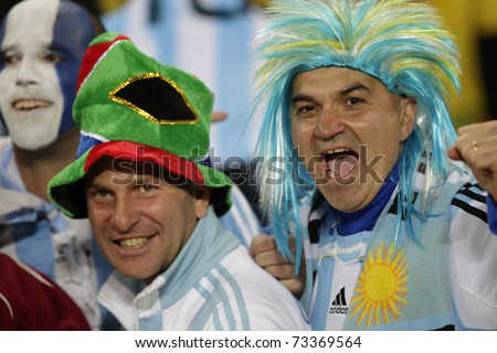 JOHANNESBURG, SOUTH AFRICA - JUNE 27:  Argentina supporters cheer at a World Cup soccer match between Argentina and Mexico June 27, 2010 in Johannesburg, South Africa. - stock photo