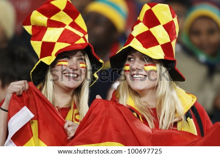 JOHANNESBURG, SOUTH AFRICA - JUNE 21:  Spain supporters smile in the stands at a FIFA World Cup match June 21, 2010 in Johannesburg, South Africa. - stock photo