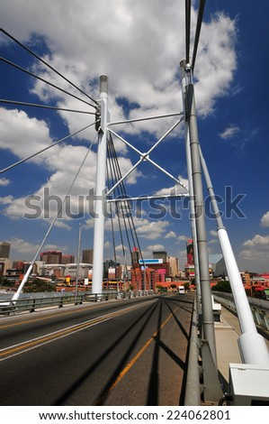 JOHANNESBURG, SOUTH AFRICA - MARCH 26, 2012: Nelson Mandela Bridge. The 284 meter long Nelson Mandela Bridge connecting Newtown, which was opened by Nelson Mandela himself.  - stock photo