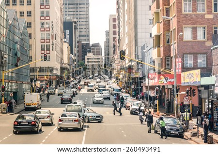 JOHANNESBURG, SOUTH AFRICA - NOVEMBER 13, 2014: rush hour and traffic jam on Von Wiellig Street at the crossroad with Comminsioner St in the crowded and modern multiracial metropolis of South Africa. - stock photo