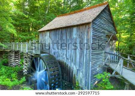 John Cable Grist Mill in the Cades Cove area of the Great Smoky Mountain National Park. This working grist mill dates back to about 1867.  - stock photo