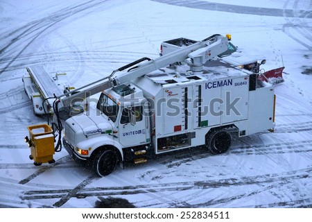 JOHN F. KENNEDY AIRPORT, NEW YORK 9 JANUARY 2015  de-icing truck is parked on the tarmac at John F. Kennedy International Airport (JFK) after a winter snowstorm. - stock photo