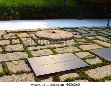 John F Kennedy Gravestone, Eternal Flame at Washington Memorial - stock photo