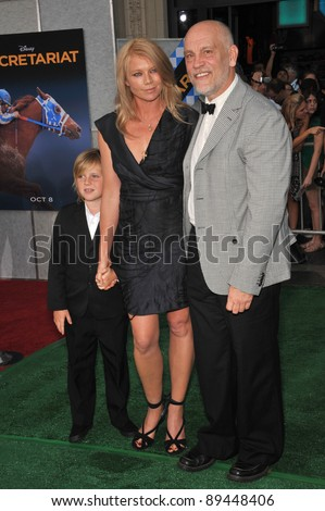 John Malkovich & wife & son at the world premiere of his new movie Secretariat at the El Capitan Theatre, Hollywood. September 30, 2010  Los Angeles, CA Picture: Paul Smith / Featureflash - stock photo