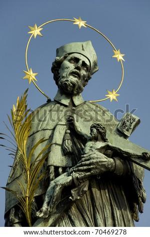John of Nepomuk statue on Charles Bridge in Prague, Czech Republic. - stock photo