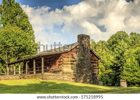 John Oliver's cabin at Cades Cove in the Great Smoky Mountains National Park was built in 1822.  This log home is now the visitor information center for Cades Cove. - stock photo