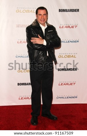 John Travolta at the Bombardier Aircraft Launch, Hanger 25, Burbank, CA 09-20-11