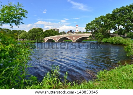 John W. Weeks Bridge over Charles River and clock tower in Harvard University campus in Boston, MA, USA - stock photo