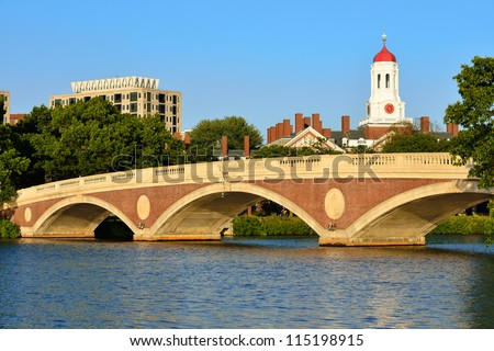 John Weeks Memorial Footbridge over the Charles River, Cambridge. White tower and red dome of Harvard University's student residence in the back. - stock photo