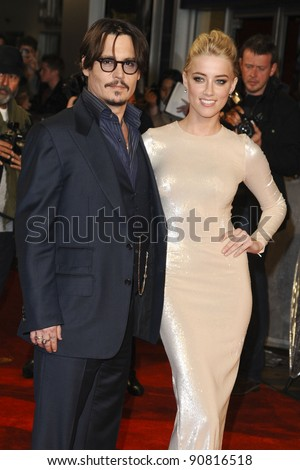"""Johnny Depp and Amber Heard arriving for the premiere of """"Rum Diary"""" at the Odeon Kensington cinema, London. 03/11/2011 Picture by: Steve Vas / Featureflash - stock photo"""