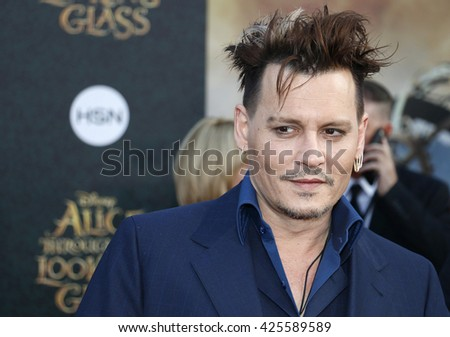 Johnny Depp at the Los Angeles premiere of 'Alice Through The Looking Glass' held at the El Capitan Theater in Hollywood, USA on May 23, 2016. - stock photo