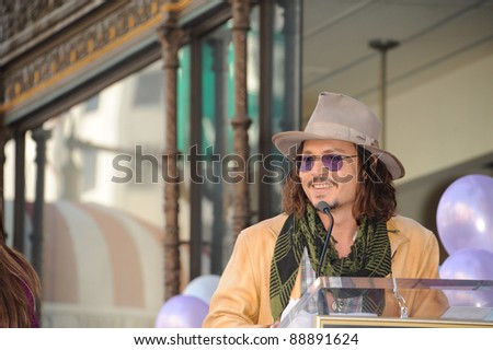 Johnny Depp on Hollywood Boulevard where actress Penelope Cruz was honored with the 2,436th star on the Hollywood Walk of Fame. April 1, 2011  Los Angeles, CA Picture: Paul Smith / Featureflash - stock photo