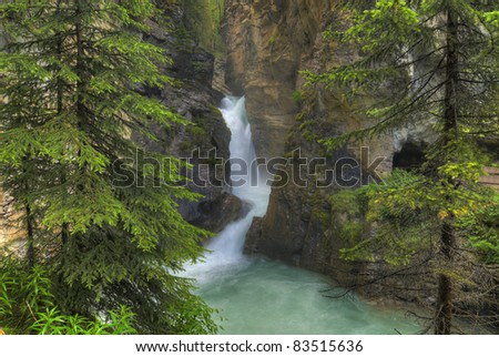 Johnston Canyon in Banff National Park in Alberta Canada. This popular tourist attraction features the turquoise blue waters of glacier melt.