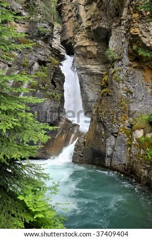 Johnston Canyon Lower Falls, Banff National Park, Alberta, Canada Vertical - stock photo