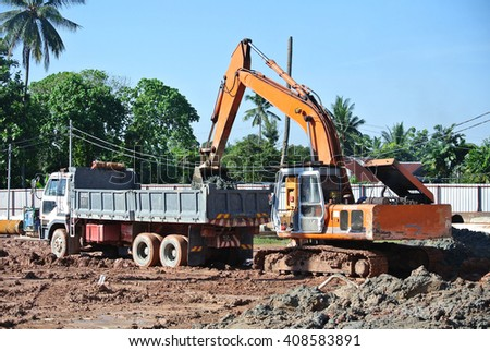 JOHOR, Malaysia -APRIL 13, 2016: Excavator machine transferred excavated soil into lorry at the construction site.