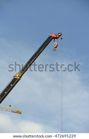 JOHOR, MALAYSIA -FEBRUARY 26, 2016: Mobile crane boom with hooks and scale weight above blue sky. The boom used to lifting heavy load.