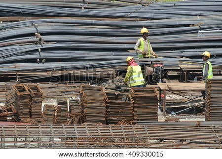 JOHOR, MALAYSIA -JANUARY 23, 2016: Construction workers working at the steel bar bending yard in the construction site.