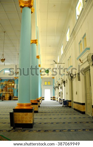 JOHOR, MALAYSIA -JANUARY 26, 2014: Interior of Sultan Ibrahim Jamek Mosque at Muar, Johor, Malaysia. It was built on 1927 and stands near the mouth of the Muar River.  - stock photo