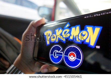 JOHOR, MALAYSIA - JULY 13TH, 2016 : An Android user plays Pokemon Go in a car, a free-to-play augmented reality mobile game developed by Niantic for iOS and Android devices.