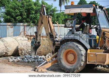 JOHOR, MALAYSIA - JUNE 26, 2015: Concrete hacking machine used to crush concrete to small pieces at the construction site in Malaysia.