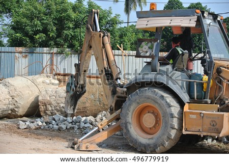 JOHOR, MALAYSIA -JUNE 26, 2015: Concrete hacking machine used to crush waste concrete to small pieces at the construction site in Malaysia.