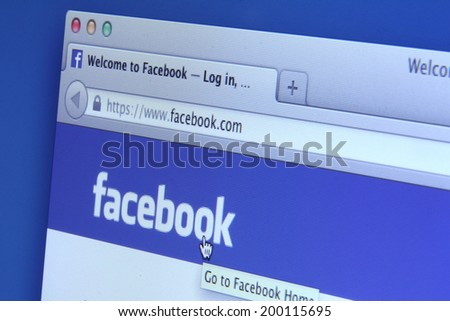 Johor, Malaysia - May 06, 2014: Facebook page on smart phone and notebook screen. Facebook is the world's largest social network, May 06, 2014 in Johor, Malaysia.