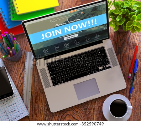 Join Now Concept. Modern Laptop and Different Office Supply on Wooden Desktop background. - stock photo