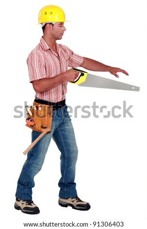 Joiner holding a saw - stock photo