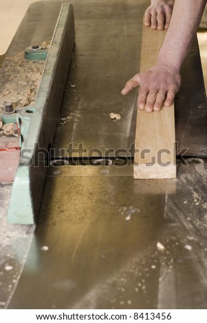 Joiner making furniture in his manufactory. - stock photo