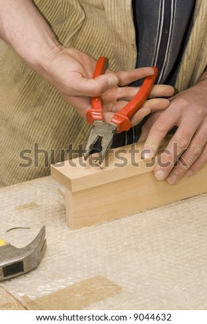 Joiner making furniture in his manufactory - stock photo
