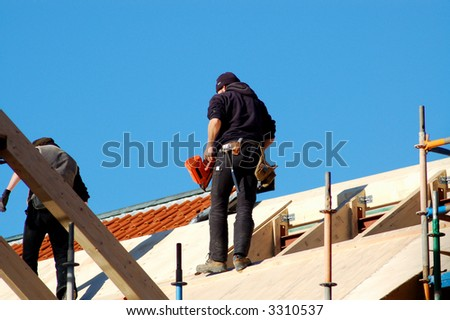 joiner on a roof - stock photo