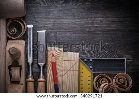 Joiners tools on wooden board construction concept. - stock photo