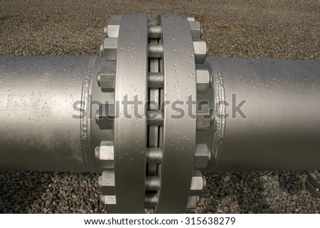 Joint of two flanges by bolts and nuts - stock photo