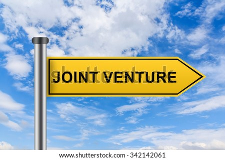 joint venture words on yellow road sign on blue sky - stock photo