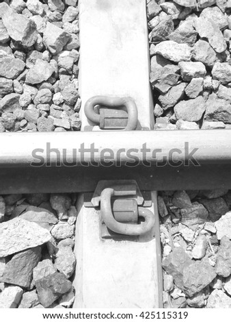 Joints on steel rails of train tracks. / A black and white - stock photo