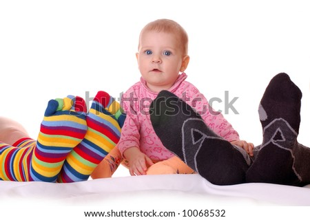 joke, little baby and feet of his parents lying unconsciousness - stock photo