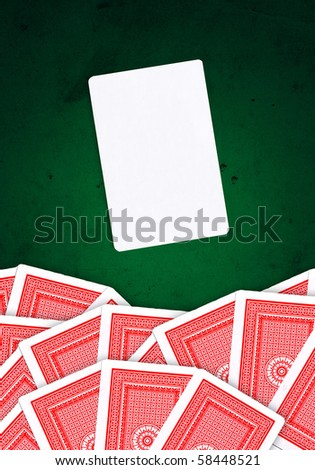 Joker card and other playing cards over green, grungy background - stock photo