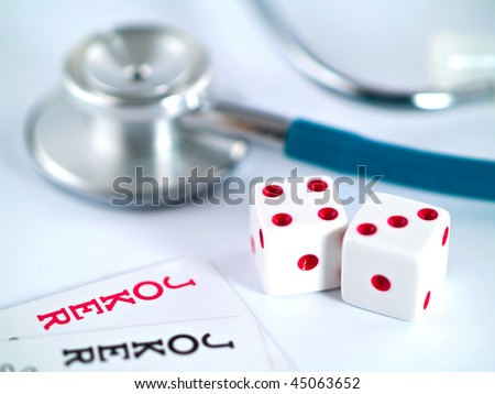 Jokers and dice and a stethoscope depicting a health gamble