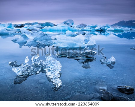 Jokulsarlon is a large glacial lake in southeast Iceland, on the borders of Vatnajokull National Park./ Colorful Jokulsarlon  - stock photo