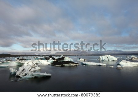 Jokulsarlon lake iceberg lagoon Southeast of Iceland, icebergs partly covered with ash - stock photo