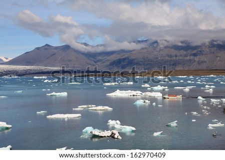 Jokulsarlon lake with iceberg near Atlantic sea in Iceland  - stock photo
