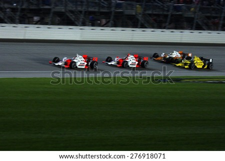 Joliet Illinois, USA - August 29, 2009: IndyCar Racing League. Nighttime Race action on track, cars running wheel to wheel, Chicagoland speedway.  Peak Antifreeze & Motor Oil Indy 300