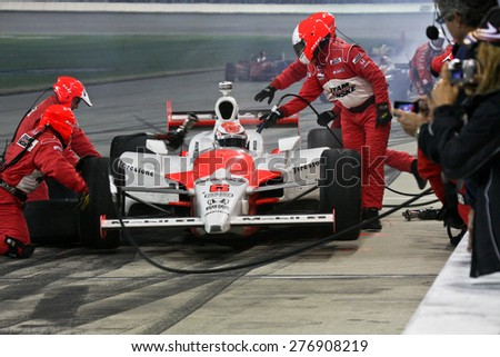 Joliet Illinois, USA - August 29, 2009: IndyCar Racing League. Pit stop during the race. Ryan Brisco driver for Penske racing. Team changes tires and fuels the car. Chicagoland speedway. Night Racing