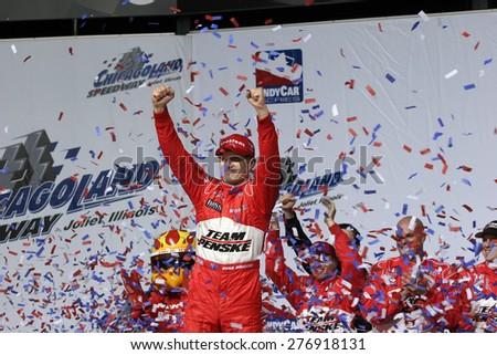 Joliet Illinois, USA - August 29, 2009: IndyCar Racing League. Victory Circle Ryan Brisco, race winner, celebrates victory. Penske racing team, Chicagoland speedway. - stock photo