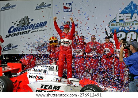 Joliet Illinois, USA - August 29, 2009: IndyCar Racing League. Victory Circle with Ryan Brisco, race winner. Penske racing team, Chicagoland speedway. - stock photo