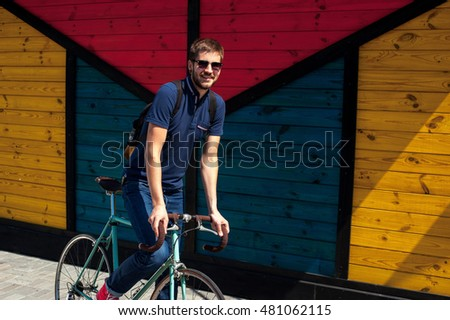 jolly bearded man with a bike around town