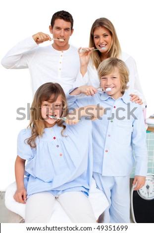 Jolly family brushing their teeth  in the bathroom - stock photo