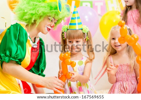 jolly kids group and clown on birthday party - stock photo