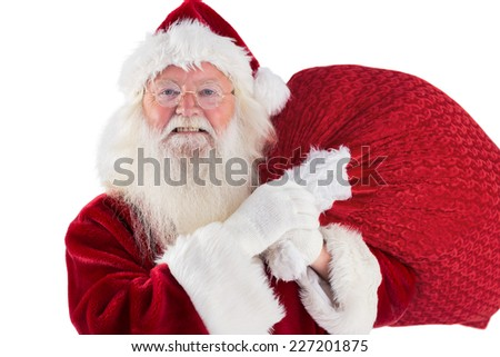 Jolly Santa carries his sack on white background